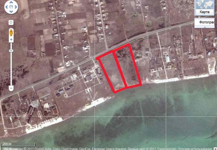 2 смежных участка на берегу моря площадью 1 га каждый. Участки находятся в центе 63765