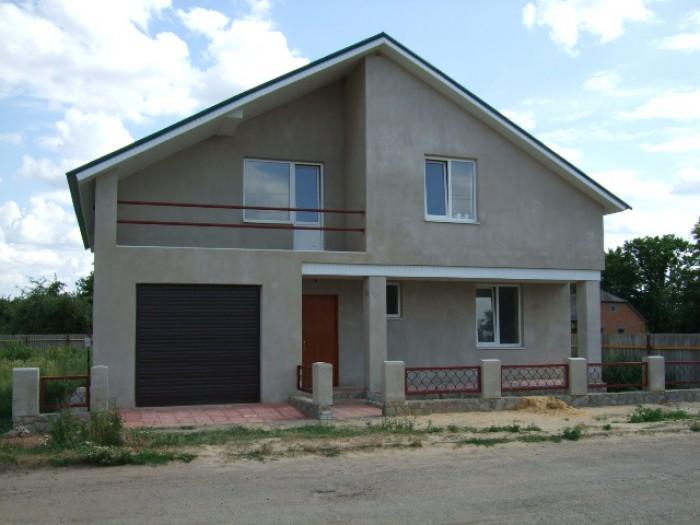 Продам дом 2009 года постройки в г.Валки. Площадь дома 223м(кухня 12.4),гараж,це 621699