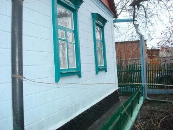 Ухоженный дом в отличном состоянии, шлакоблок обложен кирпичом, крыша шифер,  50 623219